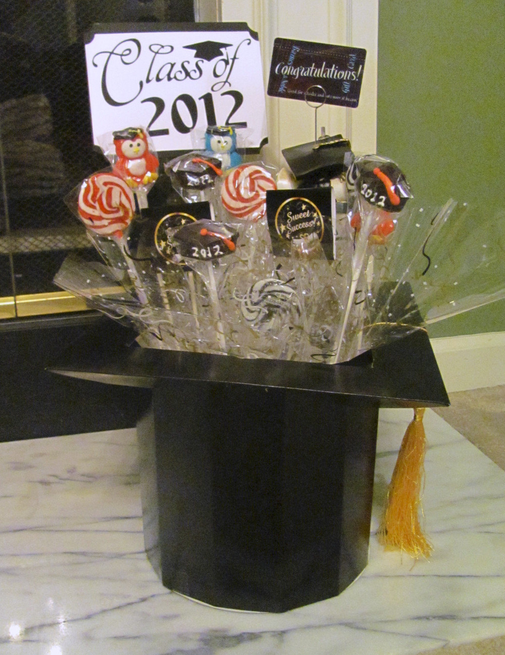 Gold Box Centerpiece : Graduation candy centerpiece featuring mortar board box on